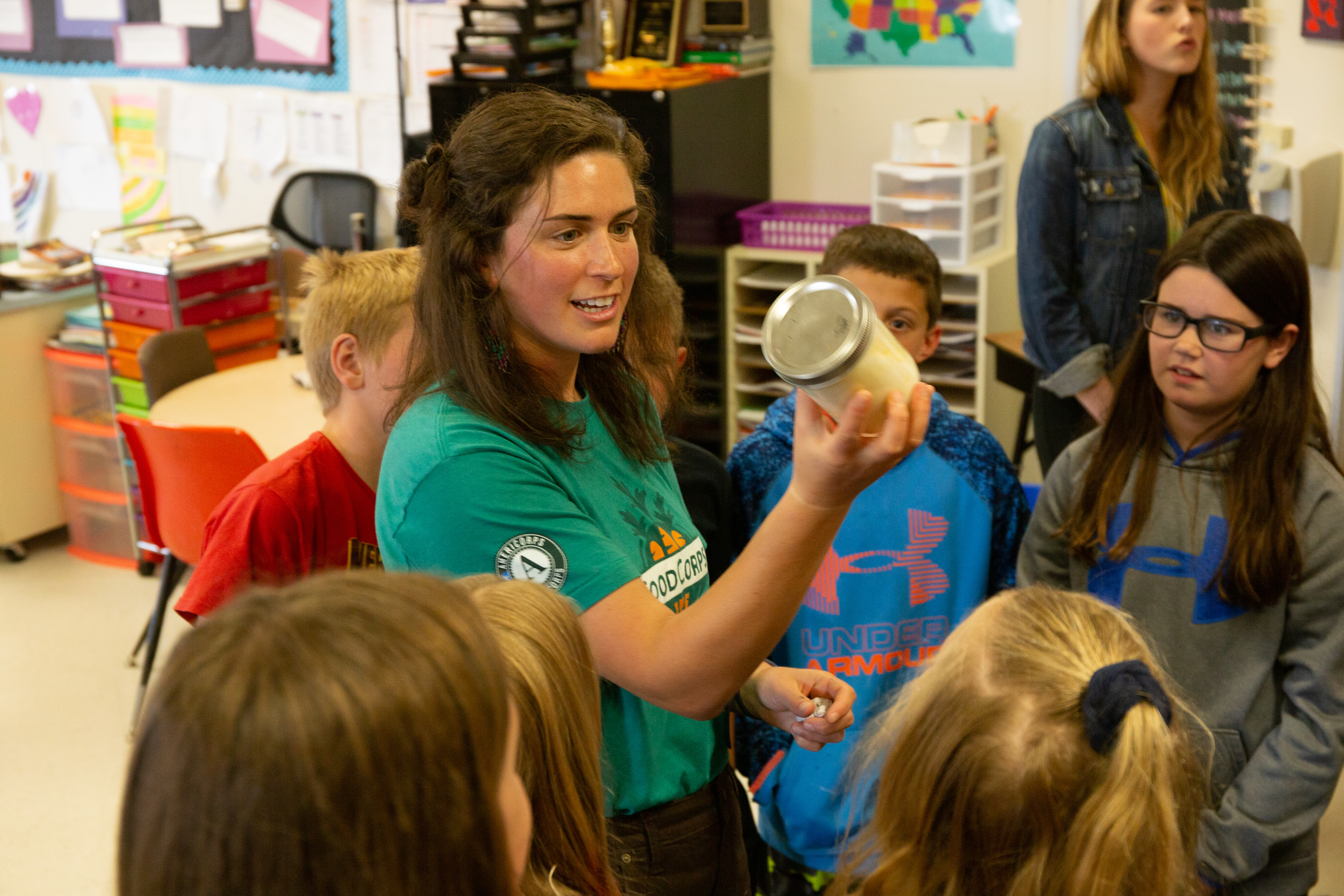A FoodCorps service member teaches young kids in the classroom.