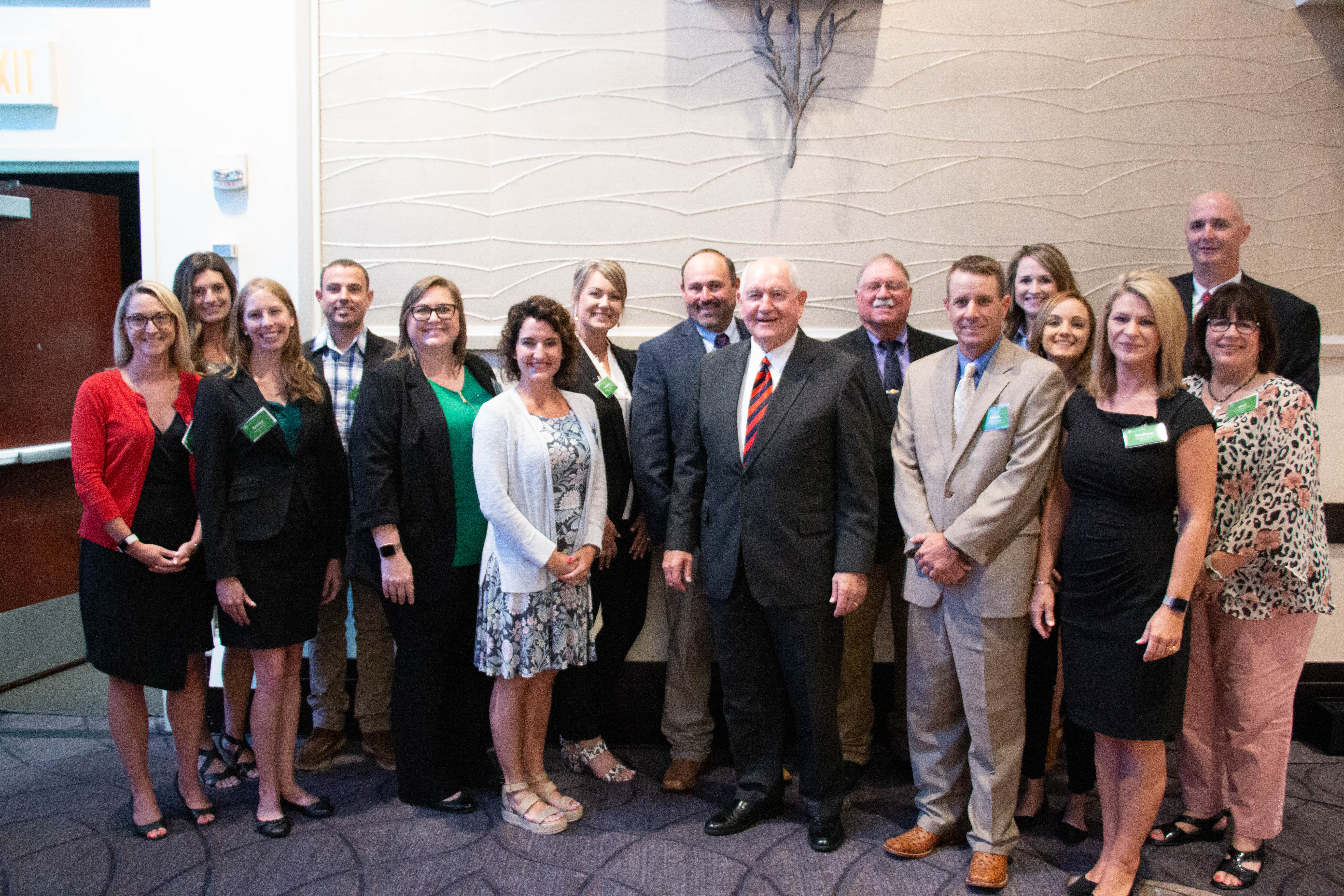 Sec. Sonny Perdue poses with fly-in attendees and Farm Credit video contest winners