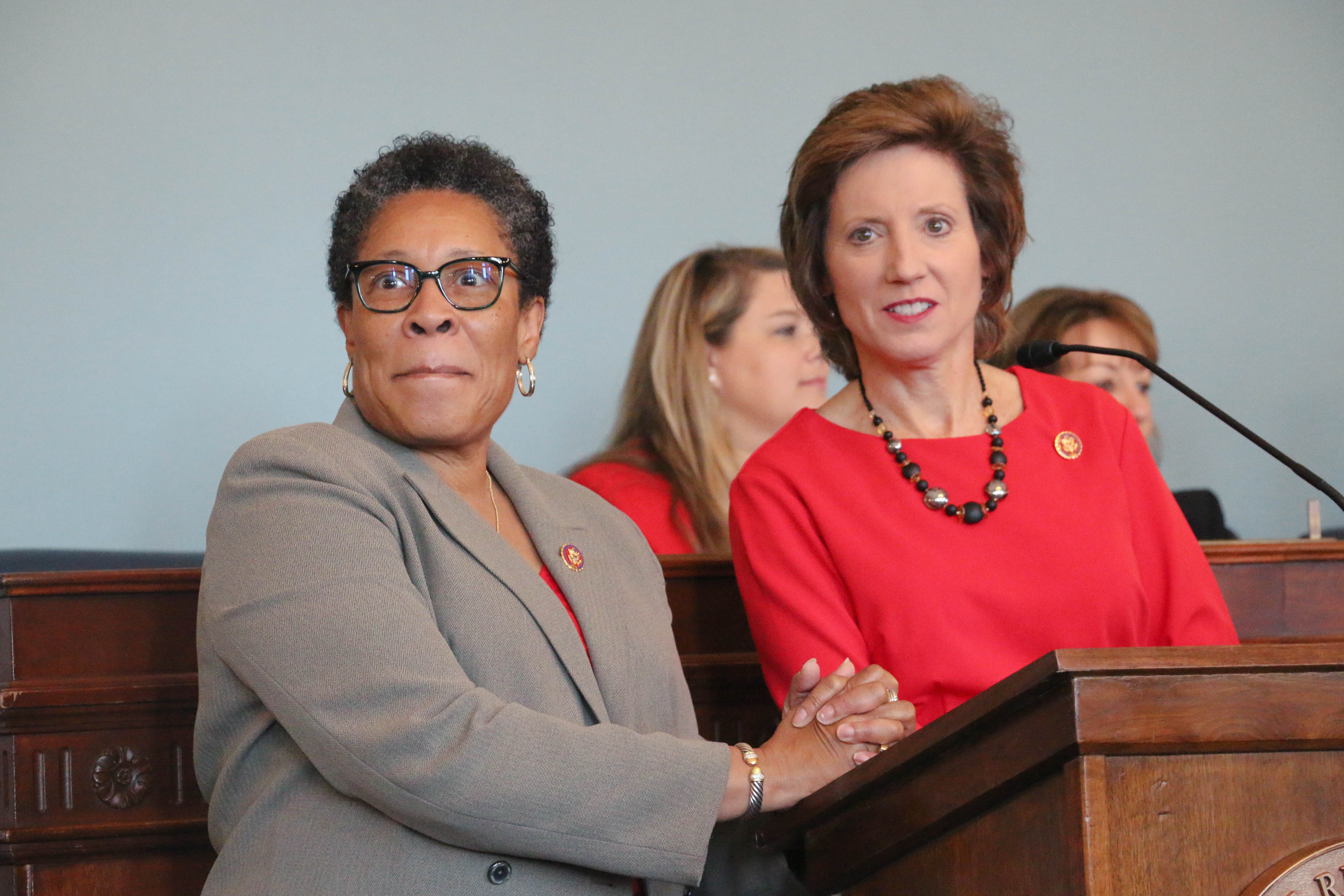 Rep. Marcia Fudge and Vicky Hartzler address women during fly-in breakfast.