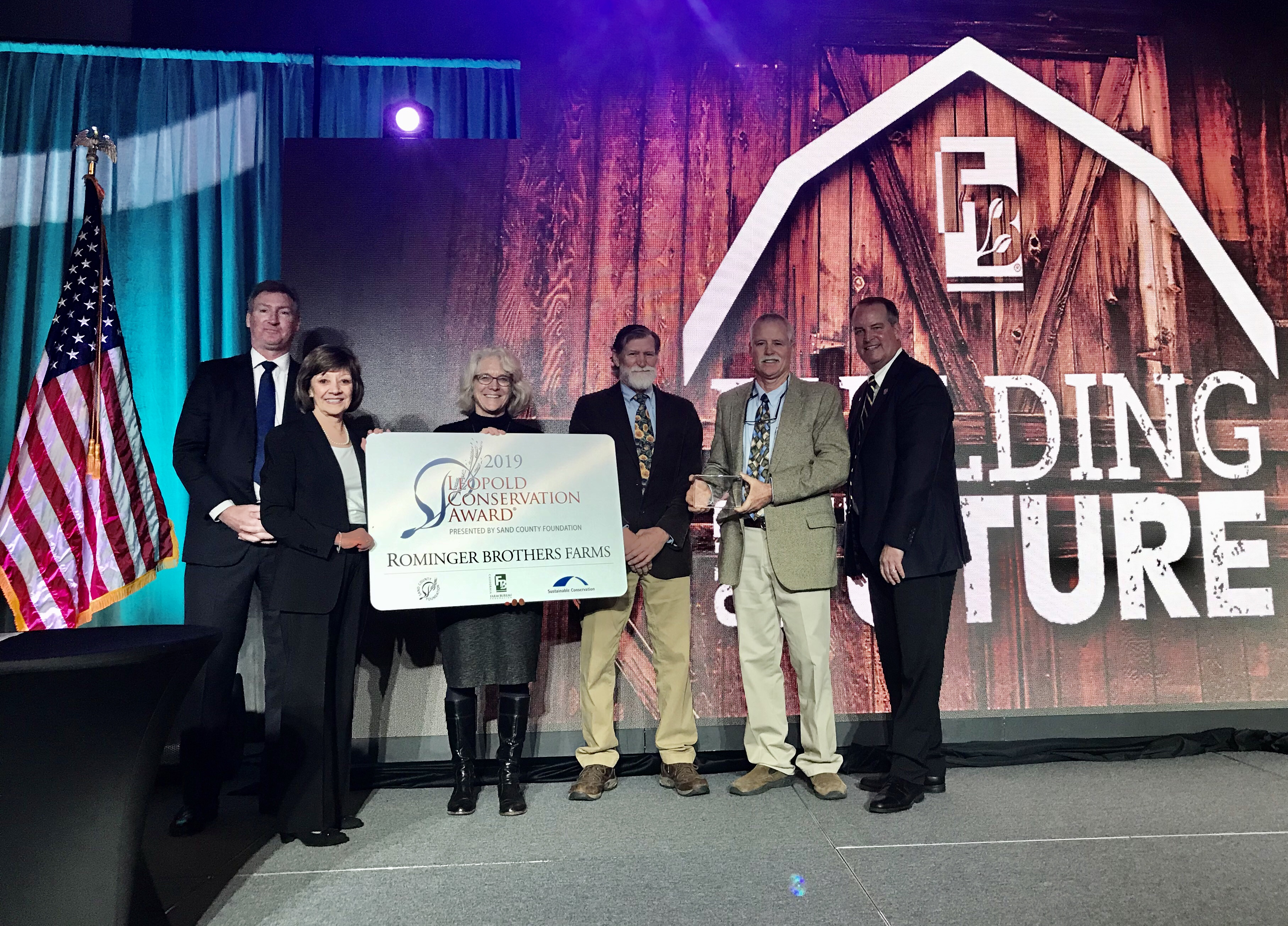 The Rominger Brothers of Yolo County were presented with the 2019 Leopold Conservation Award at the California Farm Bureau Federation's annual meeting. From left, Kevin McAleese, president/CEO of the Sand County Foundation; California Food and Agriculture Secretary Karen Ross; Ashley Boren, executive director of Sustainable Conservation; Rick and Bruce Rominger, and Farm Bureau President Jamie Johansson.