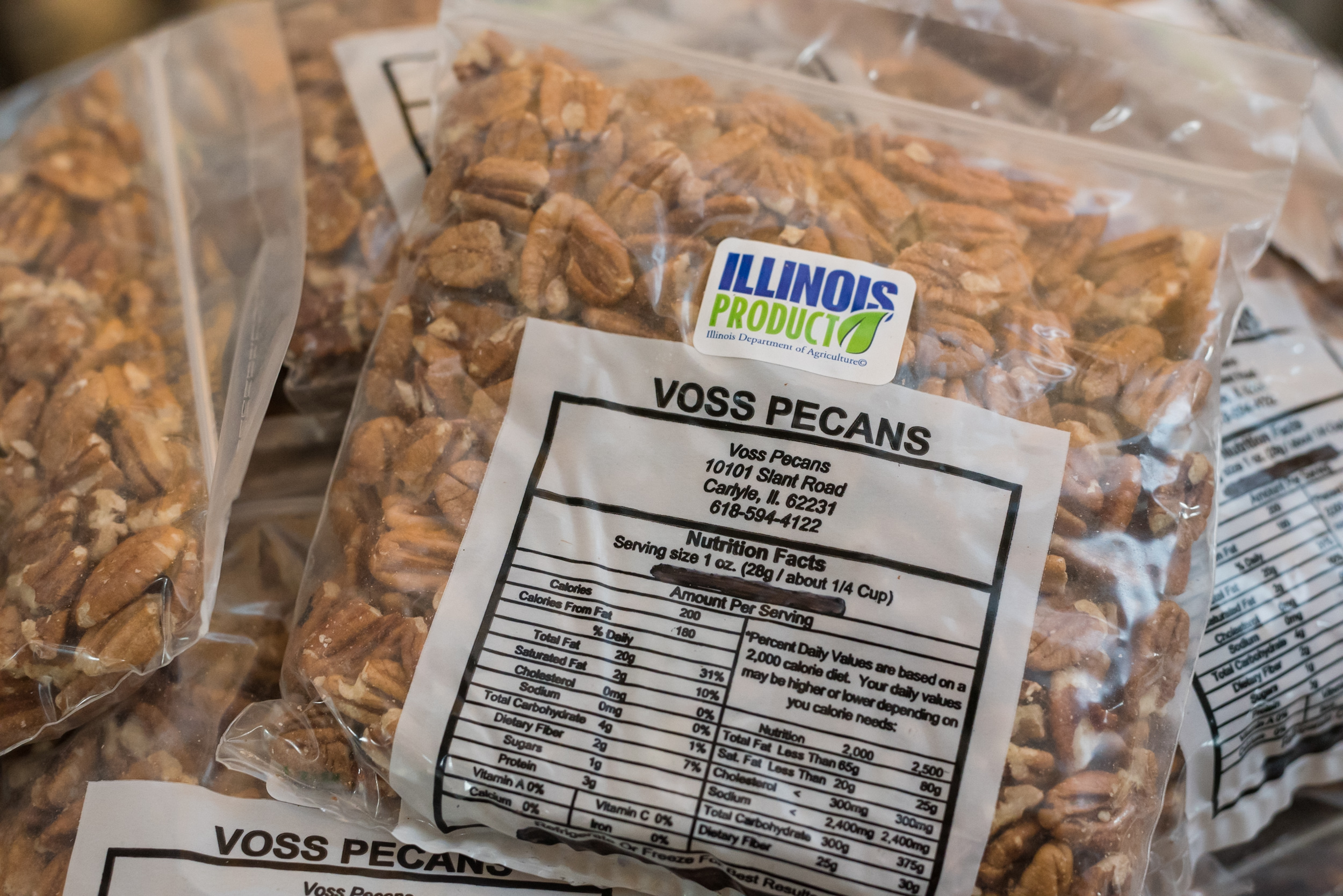 voss pecans packaged in plastic baggies with the logo on it